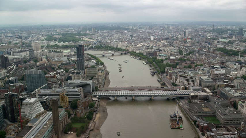 6K stock footage aerial video approach bridges while flying over River Thames, London, England Aerial Stock Footage | AX114_163