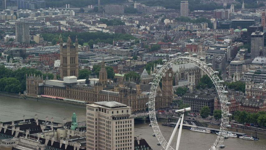 6K stock footage aerial video of the London Eye ferris wheel, Big Ben and Parliament, England Aerial Stock Footage | AX114_164