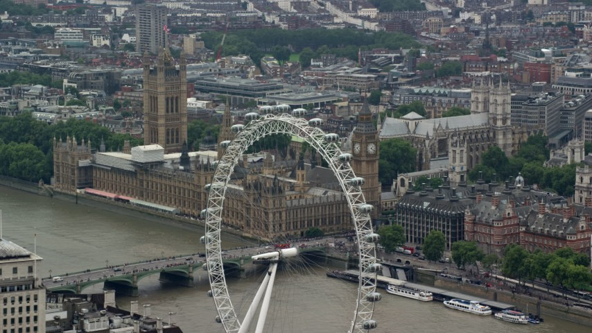 6K stock footage aerial video flyby London Eye to focus on Big Ben and Parliament, England Aerial Stock Footage | AX114_165
