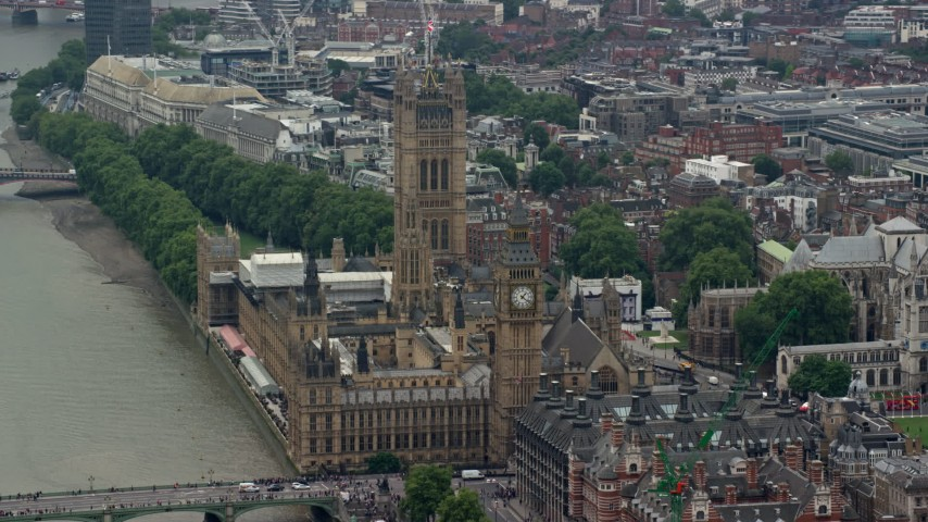 6K stock footage aerial video of passing by Big Ben and Parliament overlooking River Thames, London, England Aerial Stock Footage | AX114_167