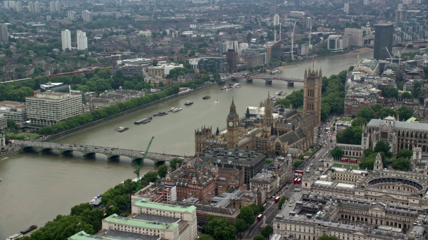 6K stock footage aerial video of Big Ben and Parliament by the River Thames in London England Aerial Stock Footage | AX114_169