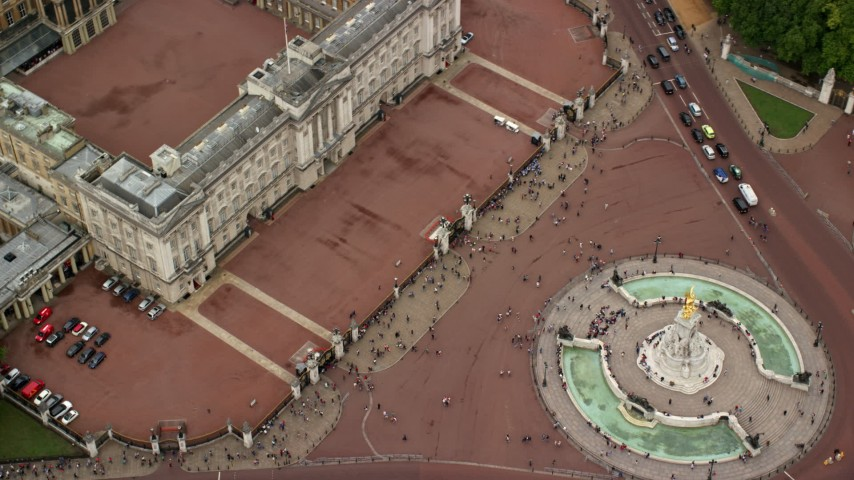 6K stock footage aerial video of a bird's eye of Buckingham Palace and tourists, London, England Aerial Stock Footage   AX114_172