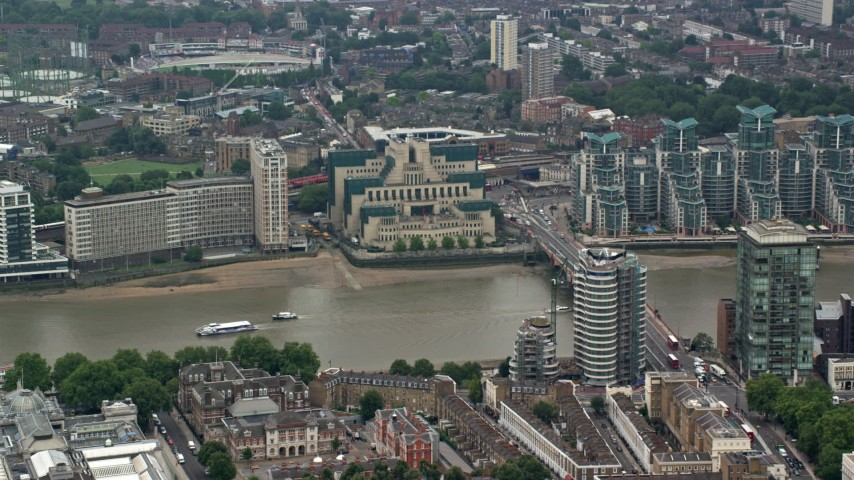 6K stock footage aerial video of MI6 Building across the River Thames; London, England Aerial Stock Footage | AX114_173