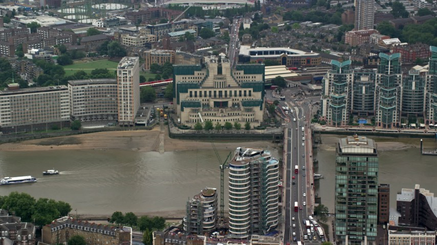 6K stock footage aerial video of MI6 Building, and Vauxhall Bridge over River Thames, London, England Aerial Stock Footage AX114_174