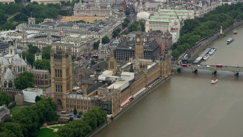 6K stock footage aerial video of Big Ben and Parliament overlooking River Thames, London, England Aerial Stock Footage | AX114_177