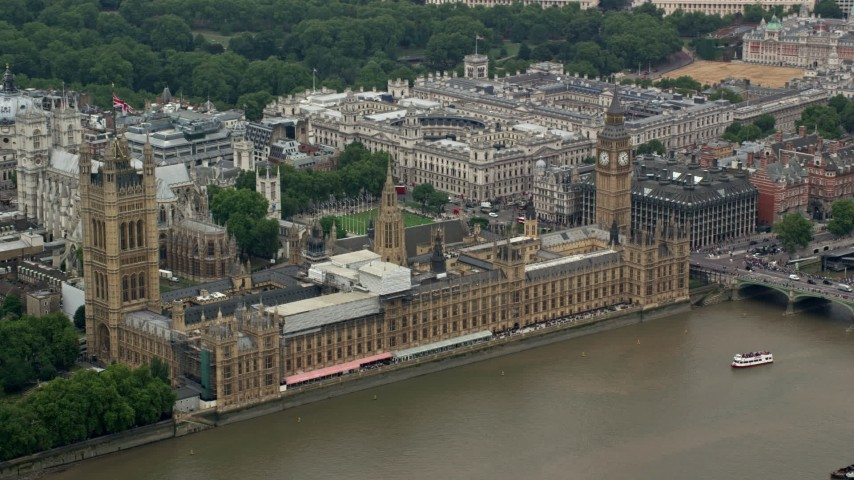6K stock footage aerial video of an orbit of Big Ben and Parliament along River Thames, London, England Aerial Stock Footage | AX114_178