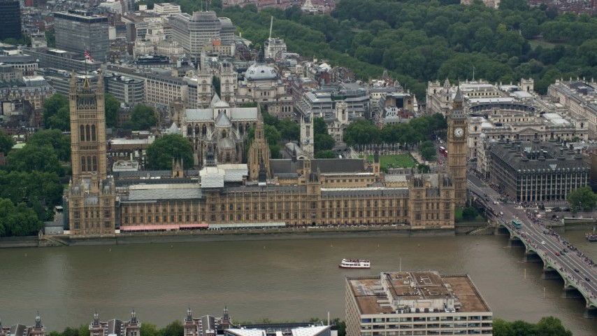 6K stock footage aerial video of passing Big Ben and Parliament across the River Thames, London, England Aerial Stock Footage | AX114_180