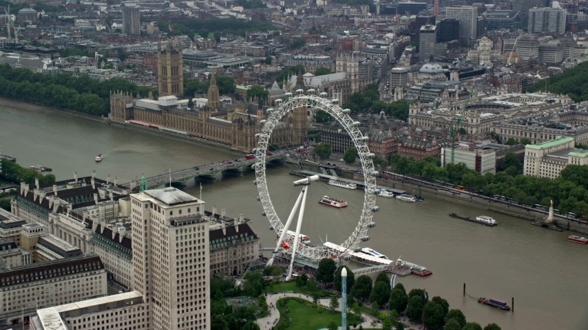 6K stock footage aerial video of London Eye with Big Ben and British Parliament in the background, England Aerial Stock Footage | AX114_184