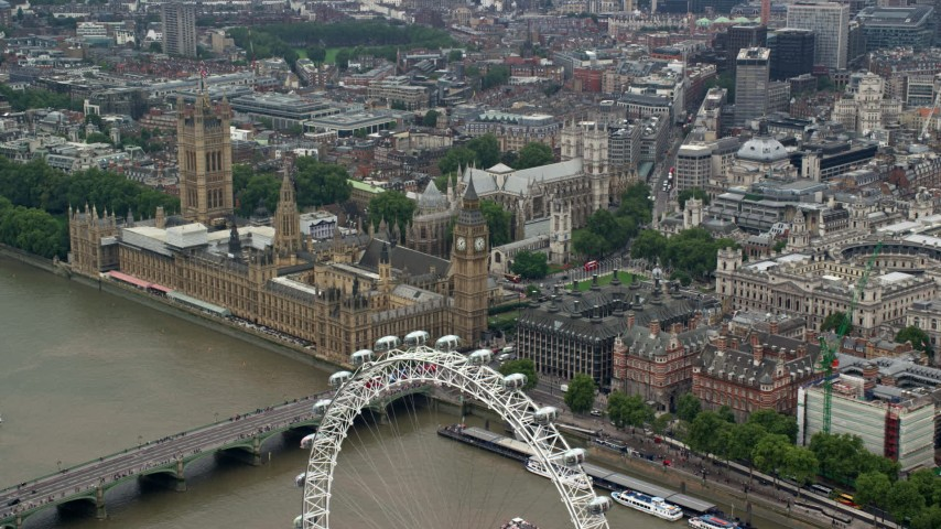 6K stock footage aerial video fly over London Eye toward Big Ben and Parliament, England Aerial Stock Footage | AX114_186