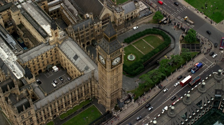 6K stock footage aerial video of tilting to a bird's eye view of Big Ben, London, England Aerial Stock Footage AX114_189 | Axiom Images