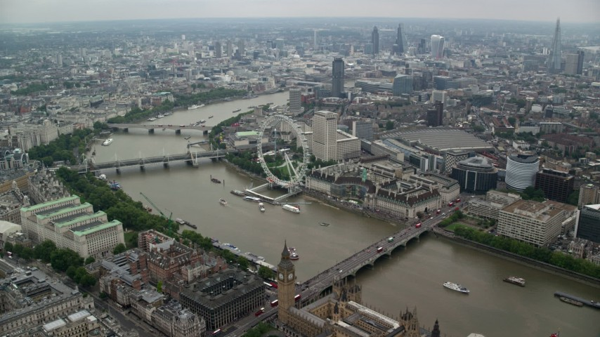 6K stock footage aerial video fly over Big Ben and Westminster Bridge toward London Eye, England Aerial Stock Footage | AX114_197