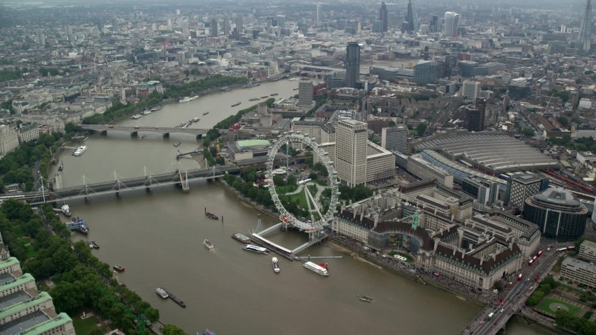 6K stock footage aerial video approach London Eye overlooking River Thames, England Aerial Stock Footage AX114_198 | Axiom Images