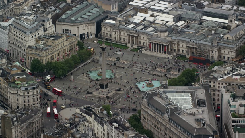 6K stock footage aerial video of orbiting Trafalgar Square, London, England Aerial Stock Footage | AX114_200