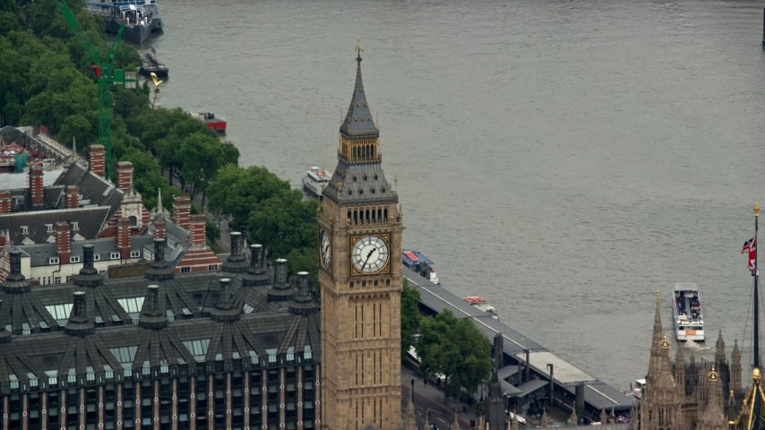 6K stock footage aerial video of Big Ben, reveal British flag, London, England Aerial Stock Footage | AX114_224