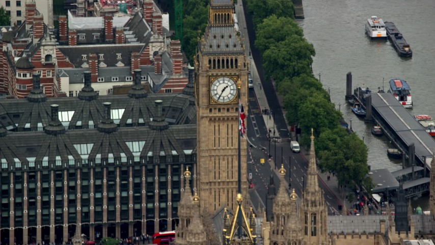 6K aerial video flyby Big Ben and the British flag, London, England Aerial Stock Footage | AX114_225