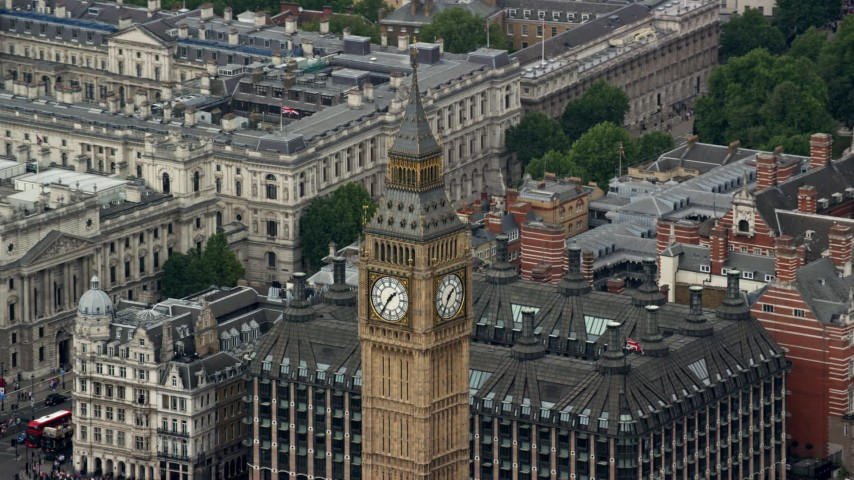 6K stock footage aerial video of orbiting Big Ben revealing HM Treasury, London, England Aerial Stock Footage | AX114_227