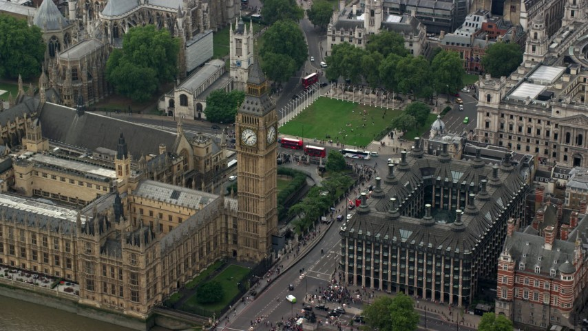 6K stock footage aerial video of Big Ben, Bridge Street and Portcullis House, London, England Aerial Stock Footage | AX114_230