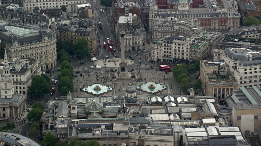 6K stock footage aerial video of Nelson's Column and fountains at Trafalgar Square, London, England Aerial Stock Footage | AX114_233