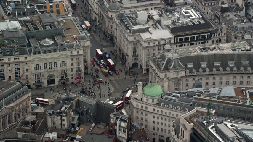 6K stock footage aerial video of orbiting Piccadilly Circus, London, England Aerial Stock Footage | AX114_234