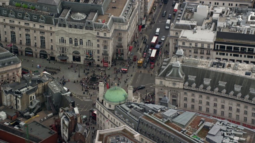 6K stock footage aerial video of orbiting Piccadilly Circus in London, England Aerial Stock Footage | AX114_235