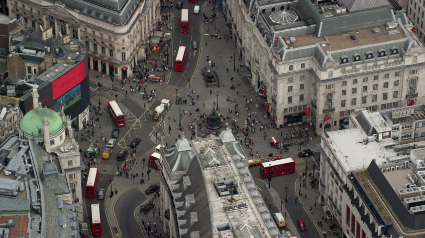 6K stock footage aerial video of an orbit of Piccadilly Circus and double decker buses, London, England Aerial Stock Footage | AX114_237