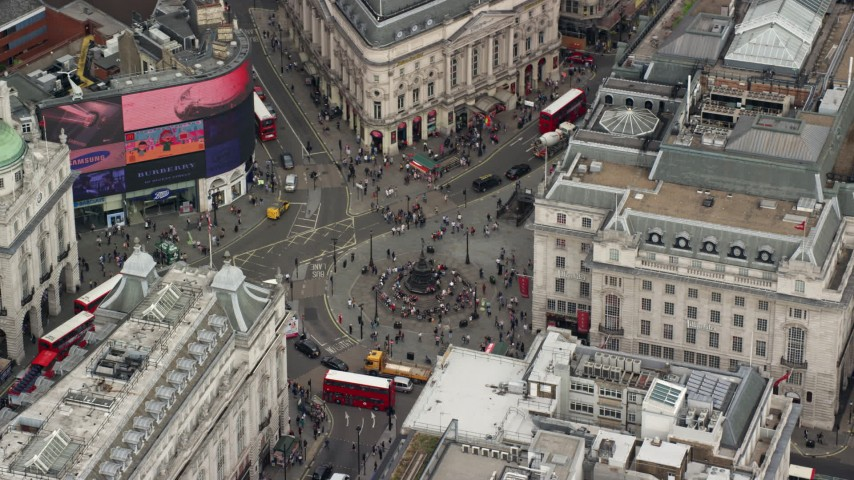 6K stock footage aerial video of orbiting double decker buses at Piccadilly Circus, London, England Aerial Stock Footage AX114_238 | Axiom Images