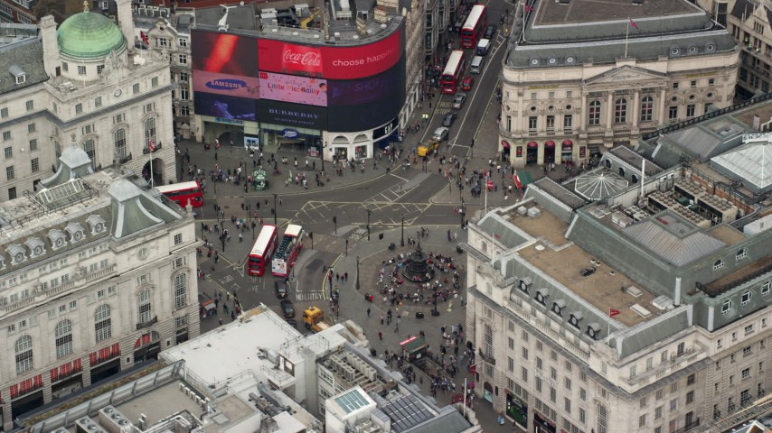 6K stock footage aerial video of circling buses and tourists at Piccadilly Circus, London, England Aerial Stock Footage | AX114_239