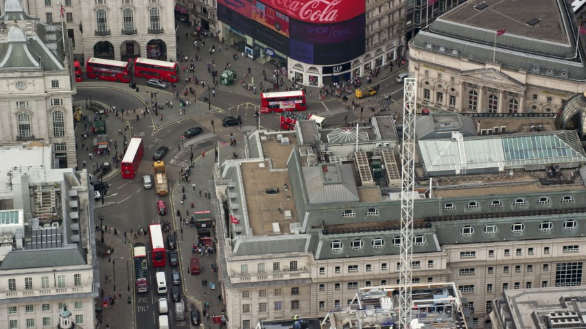 6K stock footage aerial video orbiting traffic at Piccadilly Circus in London, England Aerial Stock Footage | AX114_240