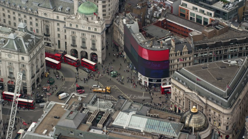 6K stock footage aerial video of an orbit around buses and traffic at Piccadilly Circus, London, England Aerial Stock Footage | AX114_241