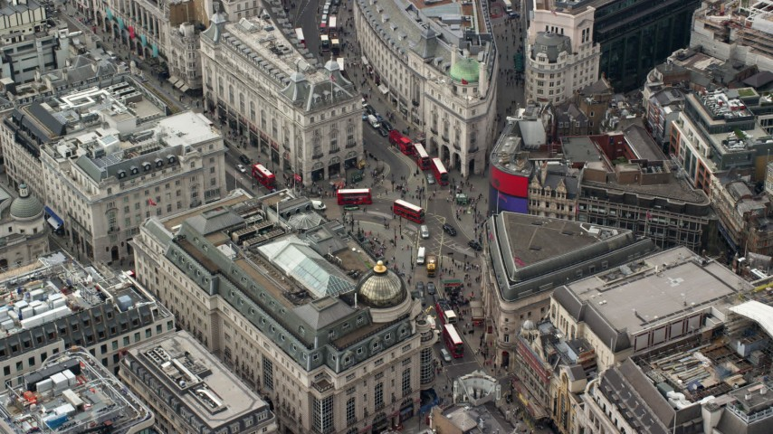 6K stock footage aerial video of Piccadilly Circus with tourists and buses, London, England Aerial Stock Footage AX114_242 | Axiom Images