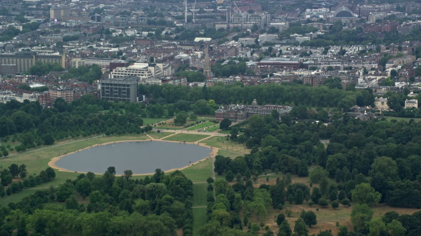 6K stock footage aerial video of Kensington Palace and Round Pond, London, England Aerial Stock Footage | AX114_249