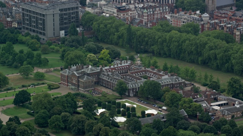 6K stock footage aerial video of Kensington Palace surrounded by trees, London, England Aerial Stock Footage | AX114_251