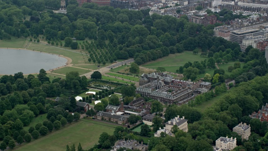 6K stock footage aerial video of circling Kensington Palace by Round Pond in London, England Aerial Stock Footage AX114_254 | Axiom Images