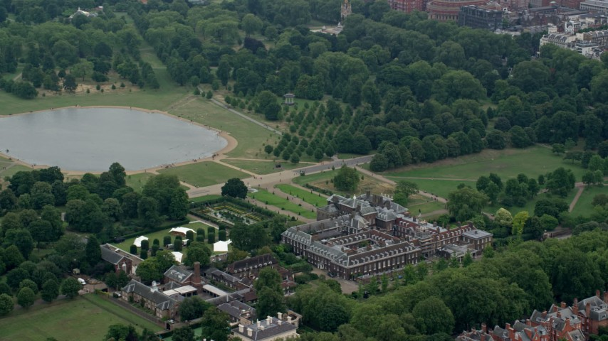 6K stock footage aerial video of orbiting Kensington Palace by Round Pond, London, England Aerial Stock Footage | AX114_255