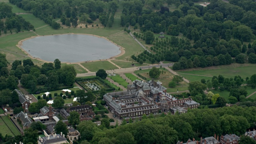 6K stock footage aerial video of orbiting Kensington Palace and Round Pond, London, England Aerial Stock Footage | AX114_256