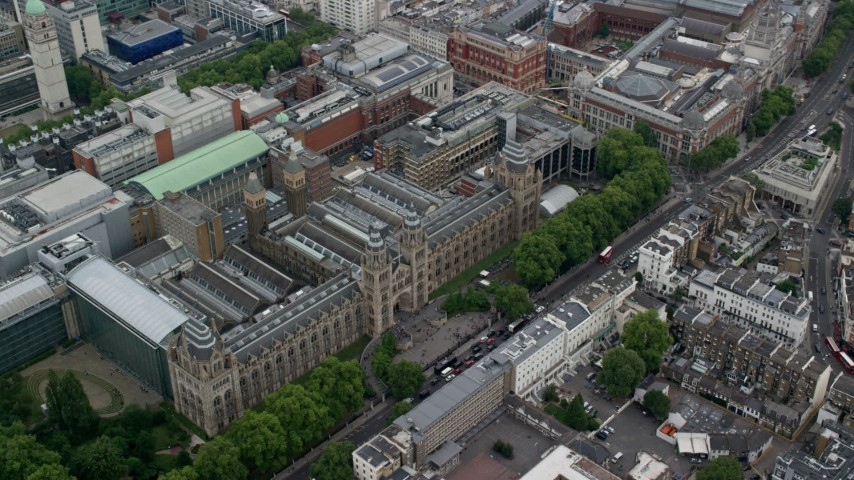 6K stock footage aerial video of orbiting Natural History Museum, London, England Aerial Stock Footage | AX114_260