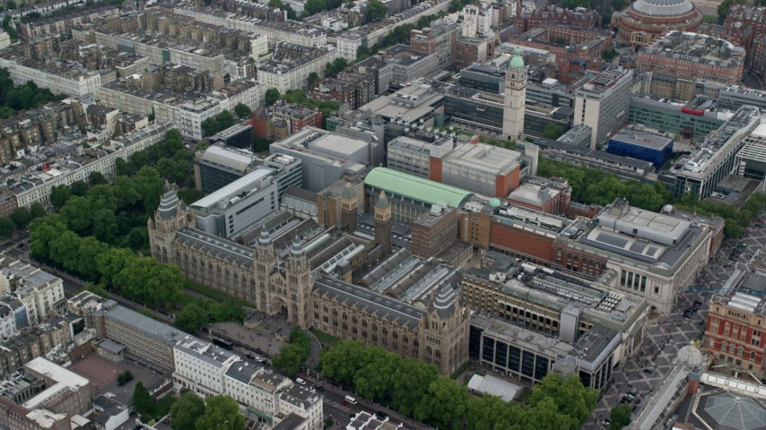 6K stock footage aerial video of orbiting Natural History Museum and Queen's Tower, London, England Aerial Stock Footage | AX114_262