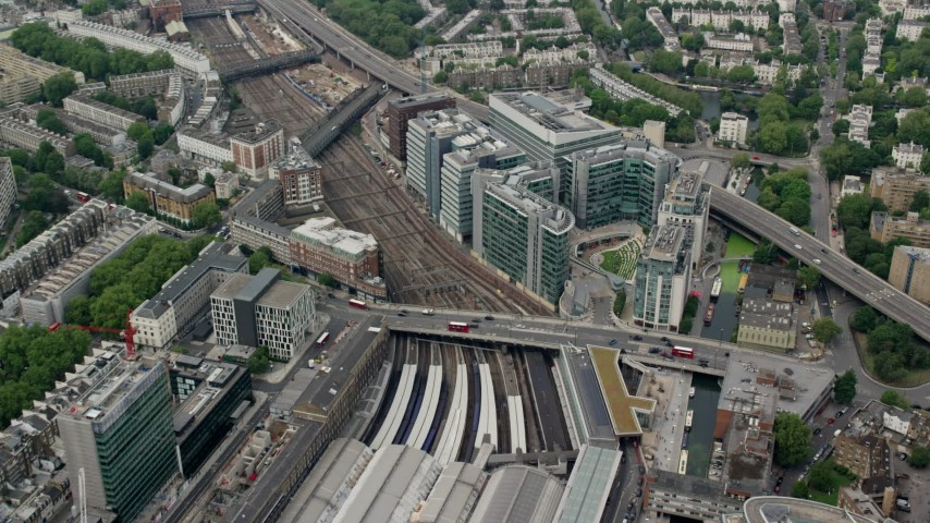 6K stock footage aerial video of London Paddington Station and office buildings, England Aerial Stock Footage | AX114_267