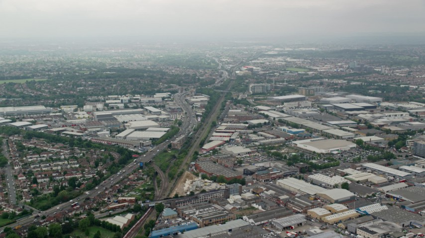 6K stock footage aerial video fly over warehouses and train tracks near the A40 highway, London, England Aerial Stock Footage | AX114_273
