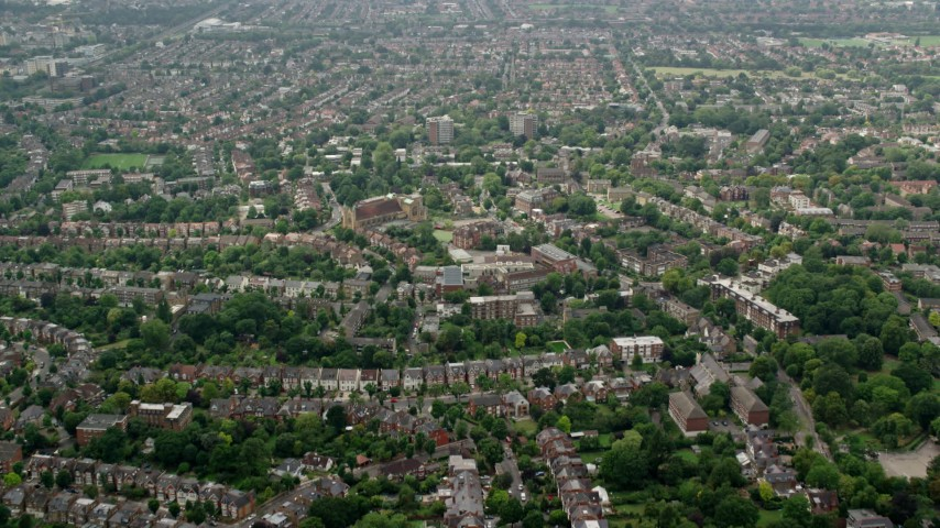 6K stock footage aerial video fly over residential neighborhoods to approach church, London, England Aerial Stock Footage | AX114_276
