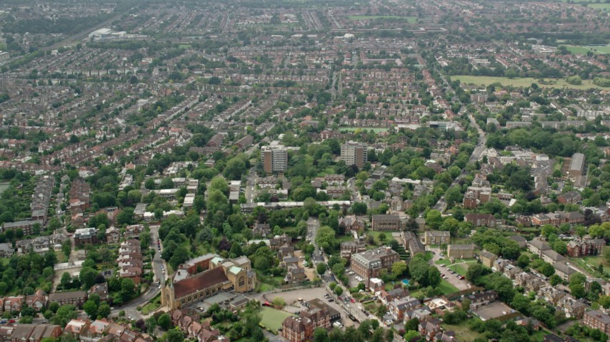 6K stock footage aerial video of residential neighborhoods and Saint Benedict's Abbey, London, England Aerial Stock Footage | AX114_277