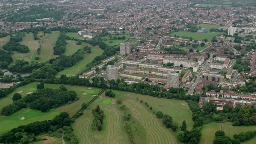 6K stock footage aerial video of approach apartment buildings from Brent Valley Golf Club, London, England Aerial Stock Footage | AX114_280