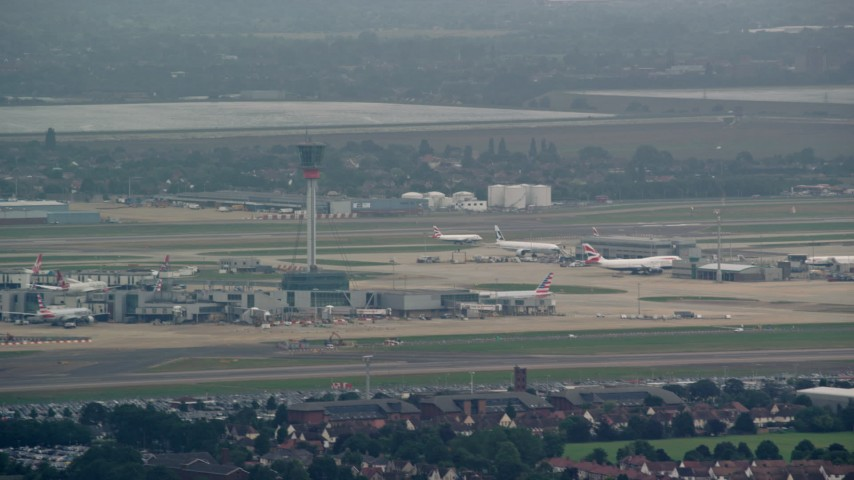 6K stock footage aerial video of control tower and aircraft at London Heathrow Airport, England Aerial Stock Footage | AX114_286