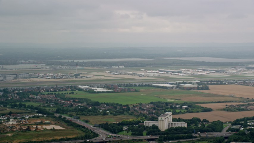 6K stock footage aerial video of approaching London Heathrow Airport, England Aerial Stock Footage | AX114_288