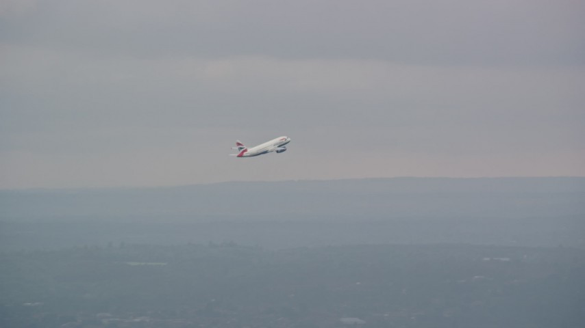 6K stock footage aerial video tracking commercial jet while ascending from Heathrow Airport, England Aerial Stock Footage | AX114_292