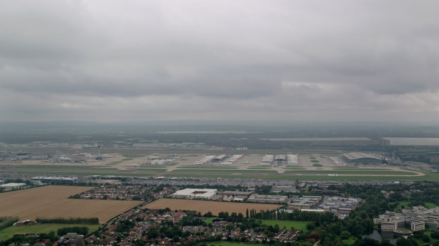 6K stock footage aerial video of passing London Heathrow Airport, England Aerial Stock Footage | AX114_293