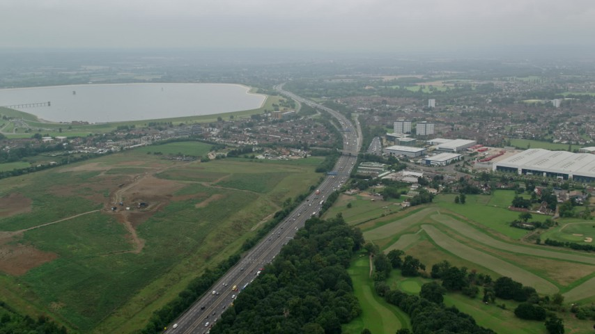 6K stock footage aerial video of M4 Freeway and warehouses, Slough, England Aerial Stock Footage AX114_295   Axiom Images