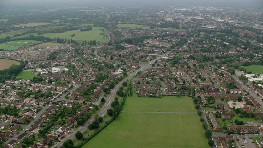 6K stock footage aerial video of residential neighborhoods around Kedermister Park, Slough, England Aerial Stock Footage | AX114_299