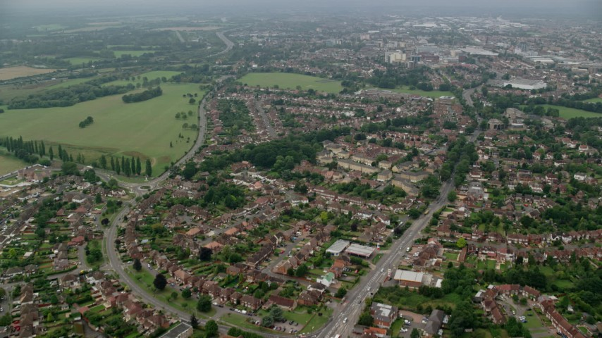 6K stock footage aerial video of residential neighborhoods by Upton Court Park, Slough, England Aerial Stock Footage | AX114_300