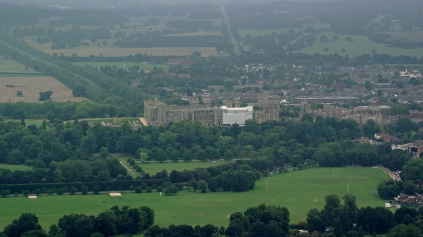 6K stock footage aerial video of a view of Windsor Castle and green trees, England Aerial Stock Footage | AX114_303